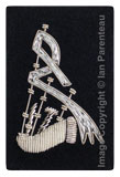 Embroidered silver wire on navy blue cloth bagpipes insignia badge