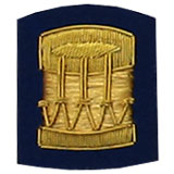 Hand Embroidered gold wire on navy blue cloth drum insignia badge