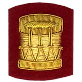 Hand Embroidered gold wire on red cloth drum insignia badge