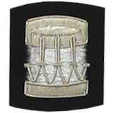 Embroidered Silver wire on black cloth drum insignia badge