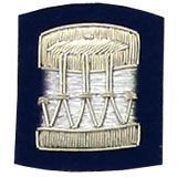 Embroidered silver wire on navy blue cloth drum insignia badge
