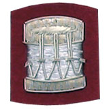 Embroidered silver wire on red cloth drum insignia badge