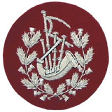 Embroidered silver wire on red cloth wreathed bagpipes Pipe Major insignia badge