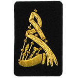 Embroidered gold wire on black cloth bagpipes insignia badge
