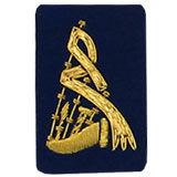Hand Embroidered gold wire on navy blue cloth bagpipes insignia badge